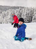 Young children playing in the snow Stock Photo