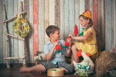 Young children playing with toys Royalty Free Stock Images