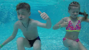 Young children in the pool stock footage
