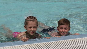 Young children in the pool stock video