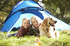 Young children pose outside of tent royalty free stock photos