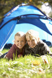 Young children pose outside of tent Royalty Free Stock Photo