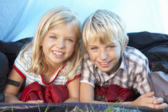 Young children pose in tent Royalty Free Stock Photography