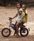 Young children posing at bicycle Stock Images