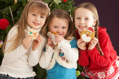 Young Children With Presents In Front Of Tree. Group Of Young Children With Presents In Front Of Christmas Tree Royalty Free Stock Photos