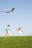 Young Children Run With Kite Stock Photos