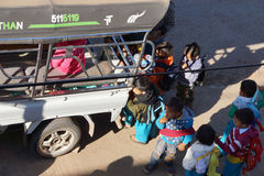 Young children and school bus Stock Images