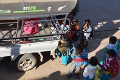 Young children and school bus. KALAW, BURMA - FEB 27, 2015 - Young children line up for the local school bus,  Kalaw,  Myanmar (Burma Stock Images