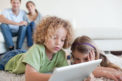 Young children using a tablet computer Stock Images