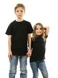 Young children wearing blank black shirts. Young boy and his sister wearing blank black t-shirts. Ready for your design or artwork Stock Image
