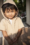 Young children wearing hood sweat with lovely face standing at h Stock Photos