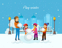 Young children in winter clothes, sculpt snowman in good mood. Stock Photos