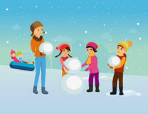Young children in winter clothes, sculpt snowman in good mood. Stock Photography