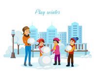 Young children in winter clothes, sculpt snowman in good mood. Stock Photo