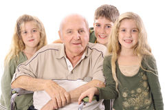 Young Children With Eldery Man Royalty Free Stock Images