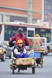 Young Chinese boy in a freight bike Stock Image