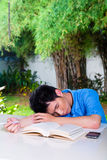 Young Chinese Boy with homework for school Stock Images