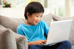 Young Chinese Boy Using Laptop Royalty Free Stock Image