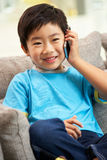 Young Chinese Boy Using Mobile Phone Stock Photos