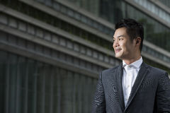 Young Chinese business executive looking away Stock Image