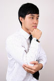 Young Chinese business man thinking. Royalty Free Stock Photos