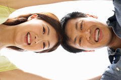 Young Chinese Couple Looking Down Into Camera Royalty Free Stock Image