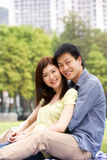 Young Chinese Couple Relaxing In Park Together Stock Photography