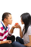 Young chinese couple sharing an apple stock images