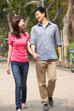 Young Chinese Couple Walking In Park Royalty Free Stock Photography