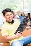 Young Chinese employee happy for his successful work on computer Stock Images