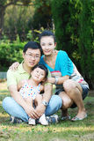 Young chinese family in outdoors Stock Image