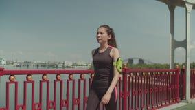 Tired after running asian woman walking on bridge stock video