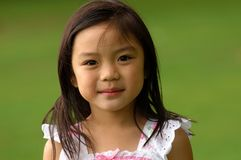 Young Chinese Girl. Young Asian Girl's portrait at the park Stock Images