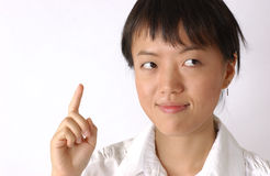 Young chinese girl. A young chinese woman has an idea, it sounds good royalty free stock images
