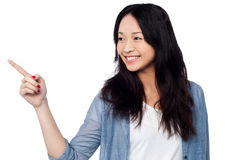 Young chinese girl pointing and looking outside Stock Image
