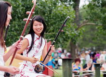 Young Chinese Lady Playing An Erhu Royalty Free Stock Photography