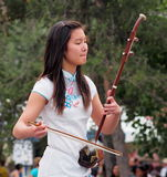 Young Chinese Lady Playing An Erhu Stock Image