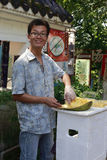 Young chinese male street vendor cutting jackfruit Stock Photo