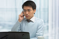 Young Chinese male working in office Stock Photography