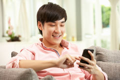 Young Chinese Man Using Mobile Phone Stock Photo