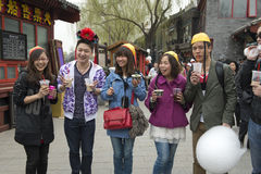 Young chinese Men and Women have fun in the entertainment district of Beijing Royalty Free Stock Image