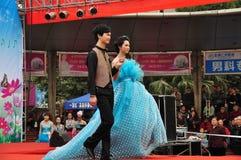 Pengzhoul, China: Models Walking the Runway. Young Chinese models walk the runway in formal dress at the Venus Wedding Plaza Spring fashion show in Pengzhou royalty free stock images
