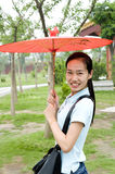 Young Chinese woman. Open Umbrellas of young Chinese girl stock photography