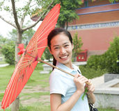 Young Chinese woman. Open Umbrellas of young Chinese girl stock images