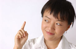 Young chinese woman. A woman seems she found an idea royalty free stock photos
