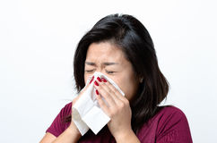 Young Chinese woman blowing her nose Stock Images