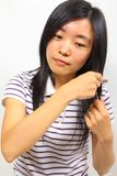 Young chinese woman brushing her hair Royalty Free Stock Photo