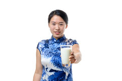 Young Chinese woman drinking a glass of milk Stock Photos