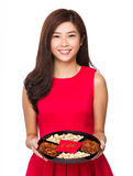Young chinese woman hold with food tray for snack Royalty Free Stock Image