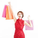 Young chinese woman holding shopping bags Stock Photo